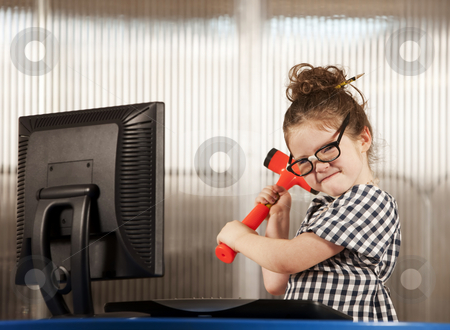 Nerdy girl smashing her computer stock photo, Nerdy young girl smashing her computer with a hammer by Scott Griessel