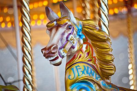Carousel horse stock photo, A colorful wooden horse on a carousel ride by Norma Cornes