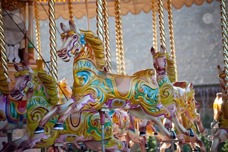Carousel horses stock photo, Colorful wooden horses on a carousel ride by Norma Cornes