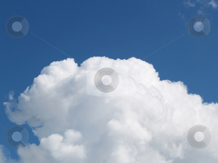 Single White cumulus cloud in blue sky stock photo, Dark blue sky with a single white fluffy cloud by Jeff Cleveland