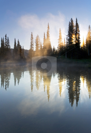 Sunrise Mist stock photo, Mist rising off the still waters of Reflection lake at sunrise by Mike Dawson