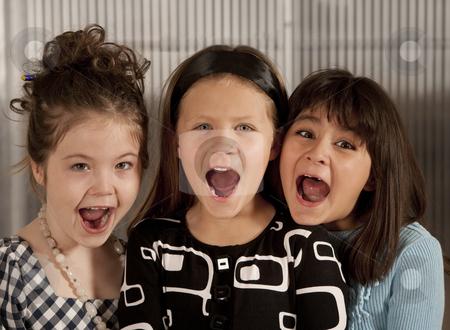 Three screaming girls stock photo, Closeup of three cute young girls screaming by Scott Griessel