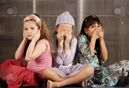 Three kids ignoring evil stock photo, Three kids in the classic denial of evil pose by Scott Griessel