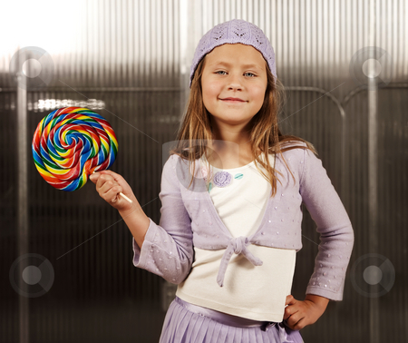 Cute young girl with lollipop stock photo, Cute young girl with lollipop and knit cap by Scott Griessel