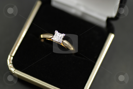 Diamond ring stock photo, Stock picture of a engagement ring with a diamond by Albert Lozano