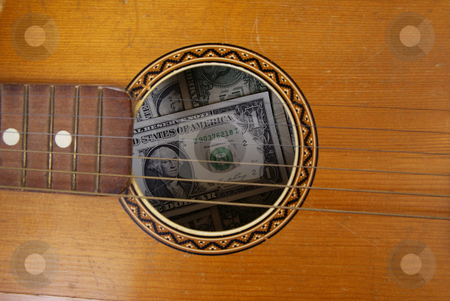 Guitar stock photo, Guitar with dollars in made as background by Jolanta Dabrowska