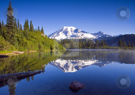 Morning Calm stock photo, The still waters of Bench LAke reflect the pristine slolpes of Mt. Rainier by Mike Dawson