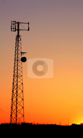 Cell Phone Tower Silhouette stock photo, A cell phone tower silhouette in the sunset by Chris Hill