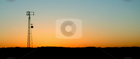 Pale Blue Cell Phone Tower Sunset stock photo, A cell phone tower silhouette in the sunset by Chris Hill