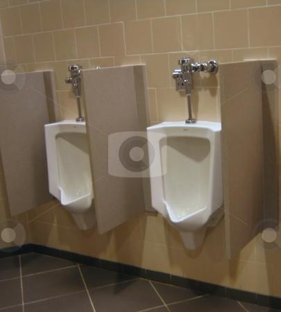 Bathroom  stock photo, Urinals in mens public bathroom by Albert Lozano
