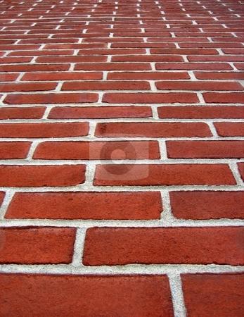 Brick wall stock photo, Bricks arranged to form a wall or a floor by Albert Lozano