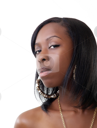 Young black woman bare shoulder portrait gold chain stock photo, Young black woman with skeptical look bare shoulders by Jeff Cleveland