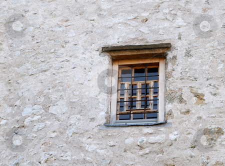 Old Window stock photo, Old closed window with bars on a stone wall. by Denis Radovanovic