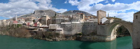 Panorama of Mostar Old Town East Side with Old Bridge stock photo, Panorama of Mostar old town east side with Old Bridge on a sunny winter day. by Denis Radovanovic