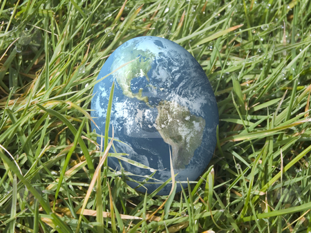 Easter egg earth in grass stock photo, Easter egg in grass painted as earth by John Teeter