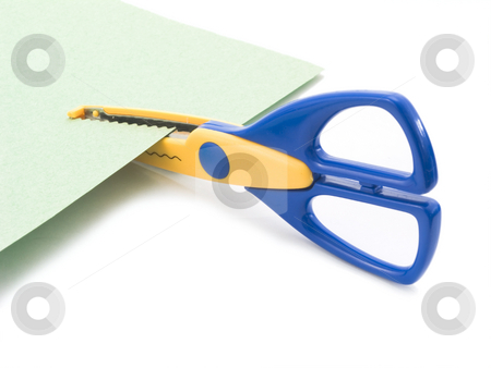 Scrapbooking on white stock photo, Scrapbooking scissors cutting paper on white background by John Teeter