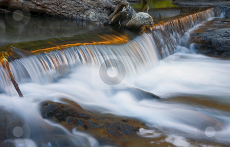 Sunset Falls stock photo, A small waterfall along the Little Naches River reflects the golden colors of sunset by Mike Dawson