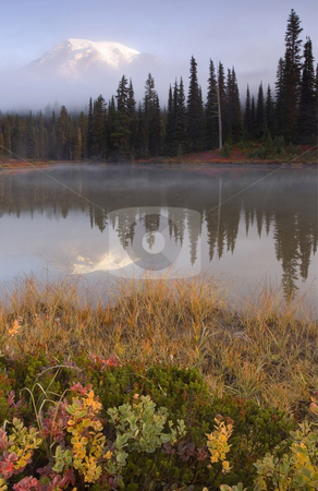 Rainier Autumn stock photo, Mt. Rainier obscured by the rising mist off an alpine lake during Autumn. by Mike Dawson