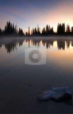 Burining Sunrise stock photo, A brilliant dawn reflecting in the still waters of an alpine lake near Mt. Rainier by Mike Dawson
