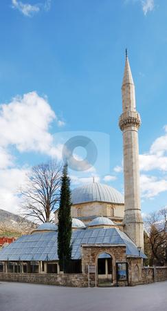 Karadjozbeg Mosque in Mostar stock photo, Karadjozbeg Mosque in Mostar, Bosnia and Herzegovina with blue sky in background. by Denis Radovanovic