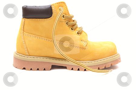 Yellow shoe stock photo, Yellow chamois shoe isolated over white by Natalia Macheda