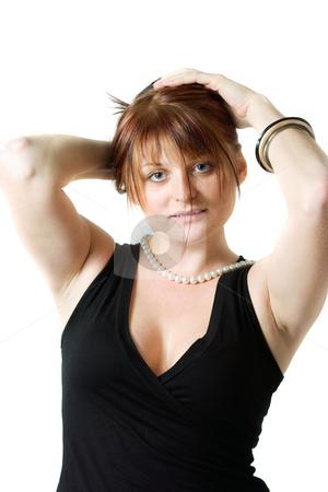 Redhead sensual woman stock photo, Redhead sensual woman touching her head by Natalia Macheda