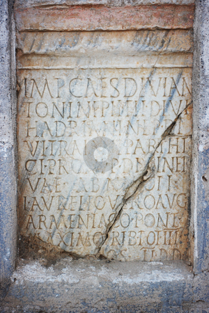 Latin text in stone stock photo, Latin text in stone slab in Gerace, Italy by Natalia Macheda