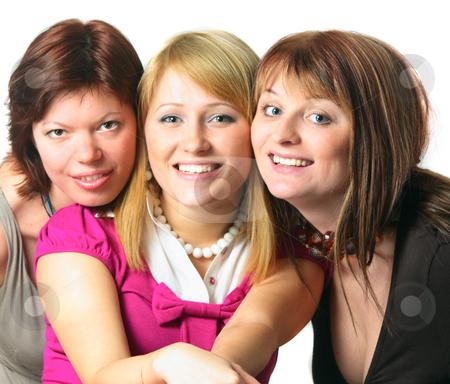 Three smiling friends stock photo, Three casual yong women enjoying friendship isolated on white by Natalia Macheda