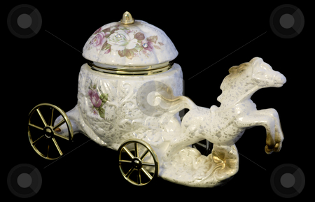 Souvenir horse and carriage stock photo, Porcelain souvenir of horse and carriage isolated over black by Natalia Macheda