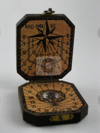 Sun dial stock photo, A pocket, small sun clock, antique by Albert Lozano
