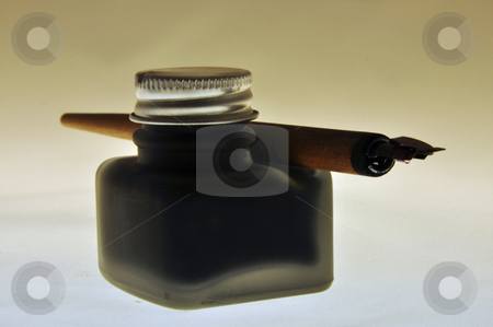 Inkwell stock photo, Classic inkwell with retro calligraphy feather isolated by Nils Volkmer