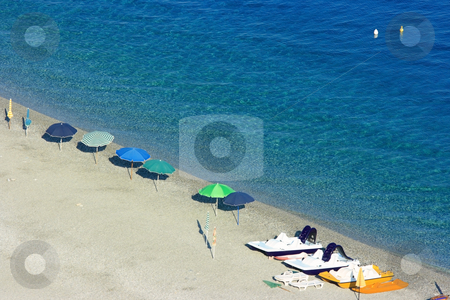 Almost empty beach stock photo, Beach with rare umbrellas and several catamarans by Natalia Macheda