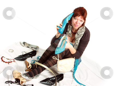 Problem of choice stock photo, Young woman lost among available accessories - concept of excessive consumption by Natalia Macheda