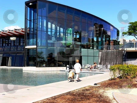 Modern building. stock photo, A modern glass building on the lake Ontario with a small pool in front of it for model boats. by Horst Petzold