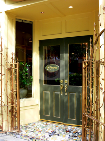 Restaurant entrance. stock photo, The entrance of a nice restaurant with an extra fancy brass gate in front of the entrance door. by Horst Petzold