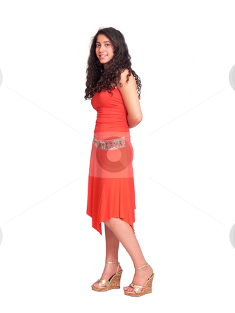 Young pretty girl   stock photo, A beautiful young girl with long dark hair and an red dress is posing on white background. by Horst Petzold