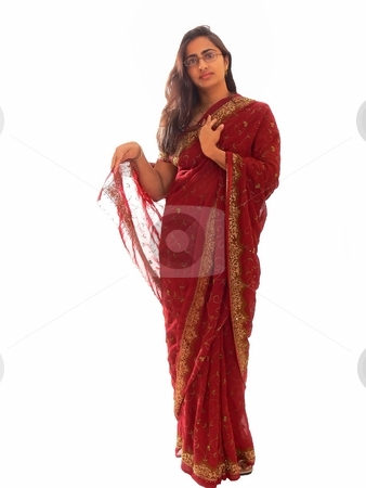 Indian lady in her native dress. stock photo, An Indian lady is standing in her elegant native red dress with her long brunette hair on white background. by Horst Petzold