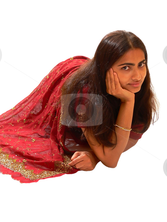 Indian lady in red dress. stock photo, An beautiful Indian lady in her native dress sitting on the floor and the camera from above, on white background. by Horst Petzold