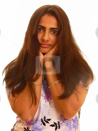 Portrait of an Indian lady. stock photo, An portrait of an pretty Indian lady holding her hair over an  white background. by Horst Petzold