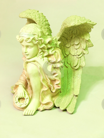 Angel  in green.  stock photo, An yellow angel with big wings on light yellow background. by Horst Petzold