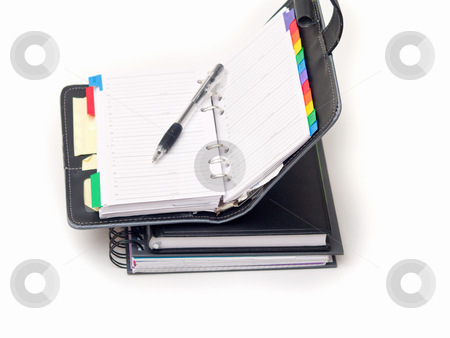 Office stationary - Pen and diary on white stock photo, Office stationary - Pen and diary on white background by Phillip Dyhr Hobbs