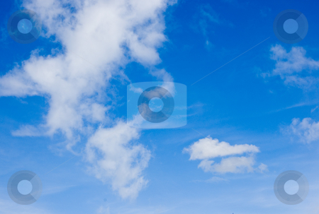 Blue Sky and White Clouds in Shape of Man's Face stock photo, Blue sky and white puffy clouds resemble a man's face in this photo. by Valerie Garner