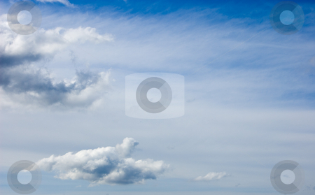 Blue Sky and White Clouds Situated Left stock photo, Photo of blue sky with both wispy white overcast and fluffy white clouds situation mostly to the left orientation of the picture. by Valerie Garner