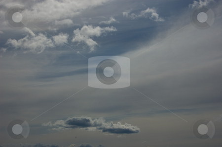 Dark Skies stock photo, This sky photo is a darkened sky with several different types of cloud patterns for a smokey, stormy look. by Valerie Garner