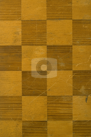 Checker board background stock photo, An old worn and stained checker board by Jonathan Hull