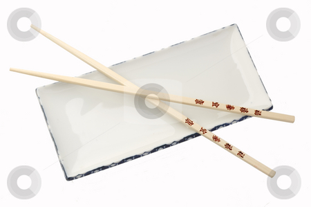 Wooden chopsticks stock photo, Wooden chop sticks on an empty plate by Jonathan Hull
