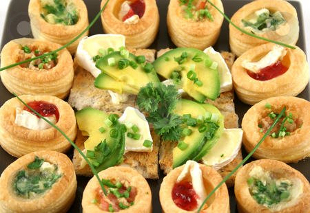 Camembert Bites And Vol Au Vonts stock photo, Assorted vol au vonts and avocado and camembert bites on a platter. by Brett Mulcahy