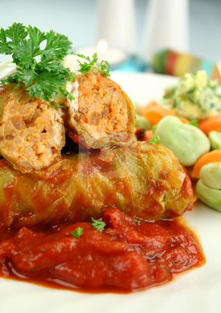 Cabbage Rolls stock photo, Baked cabbage rolls with carrots and broad beans with a tomato sauce. by Brett Mulcahy