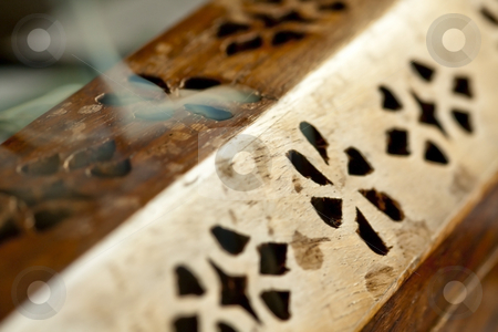 Smoking incense burner stock photo, Close up of an intricate incense burner, showing smoke pouring out the top by Chris Alleaume