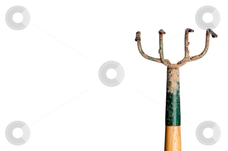 A horizontal view of a wood and metal garden hoe covered with di stock photo, A horizontal view of a wood and metal garden hoe covered with dirt on white by Vince Clements